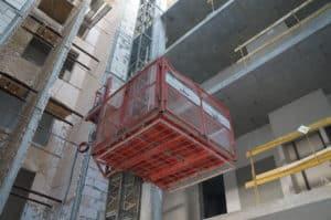 Мачтовый грузовой строительный подъемник ENCOMAT, Испания model: IZA 1500